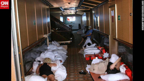 This CNN photo shows passengers lying in beds in a hallway on the Carnival Triumph. I chose this photo because the others from the collection are simply too disgusting to look at this early in the morning.