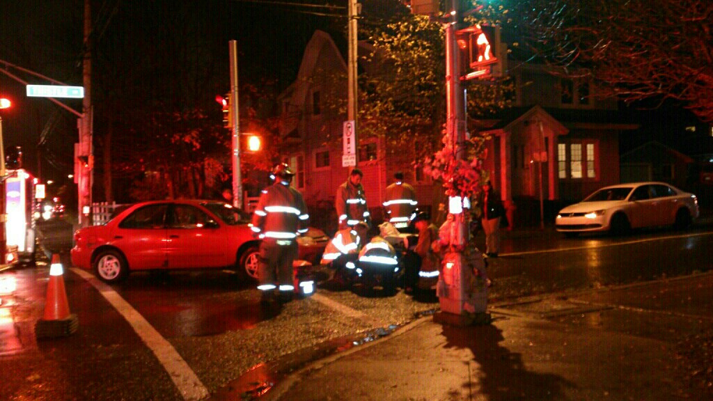 Emergency responders attend to a woman pedestrian hit at the corner of Victoria Road and Thistle Street last night.