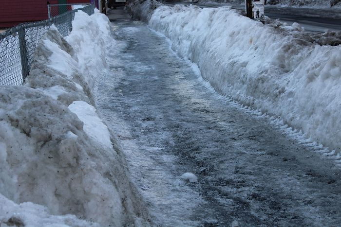 The sidewalk along Gottingen Street, like most sidewalks in Halifax, is covered with ice and presents a hazard, especially for people with mobility issues.