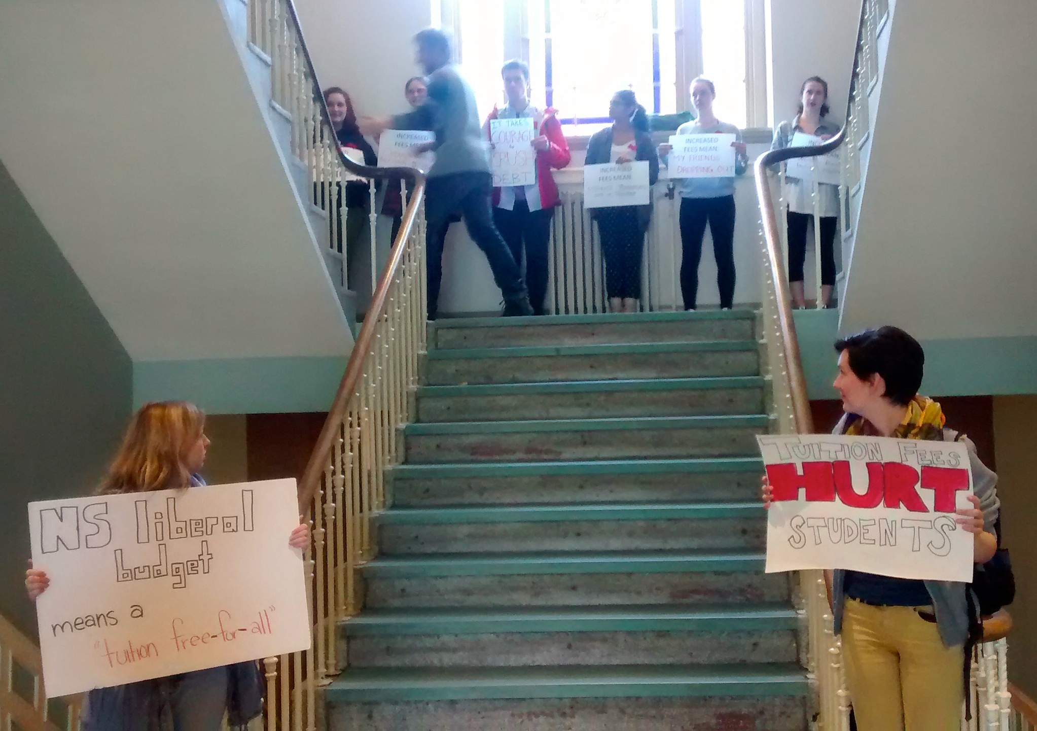 King's Students protesting fee hikes watch a Board member ascend the stairs Photo: Moira Donovan