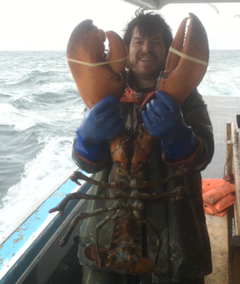 Jess Tudor with his 17-pound lobster. Photo: Facebook