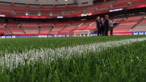 FIFA officials show off the Women's World Cup turf at BC Place. Photo: CBC