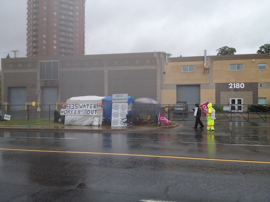 Halifax Water workers walk the picket line outside the sewage plant in the rain earlier this month. Photo: Halifax Examiner