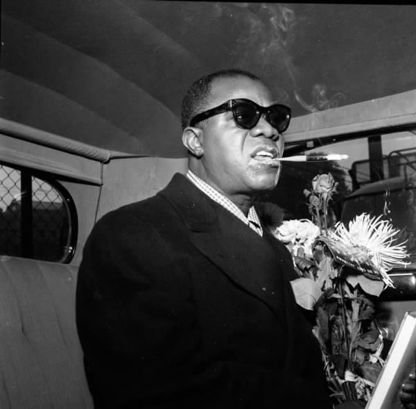 Louis Armstrong, smoking pot.