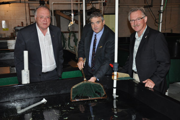 Federal minister Keith Ashfield, Scotian Halibut executive Brian Blanchard and MP Gerald Keddy celebrate a $400,000 loan to the company. Photo: South Coast Today
