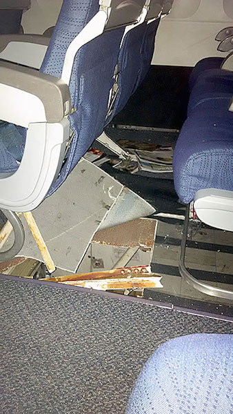 View of damage to floor at row 31 seats D, E, F.