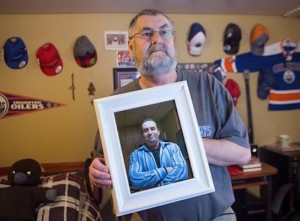 Ernie LeBlanc hold a photo of his son Jason LeBlanc at their home in Sydney Mines, N.s. on Monday, March 14, 2016. Jason died in custody at the Cape Breton Correctional Centre in January. THE CANADIAN PRESS/Andrew Vaughan