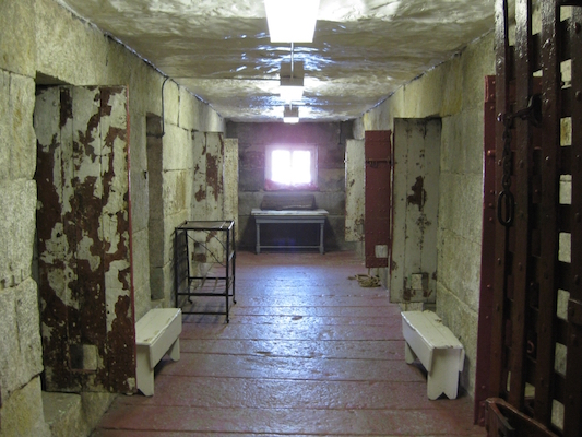 The old jail in St. Andrew's, New Brunswick. Hutchings' cell is one the left at the end of the hall.