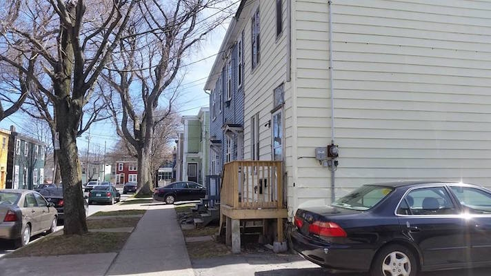 Looking northeast on McCully Street; the houses on the right are planned to be razed. Photo: Chris Parsons
