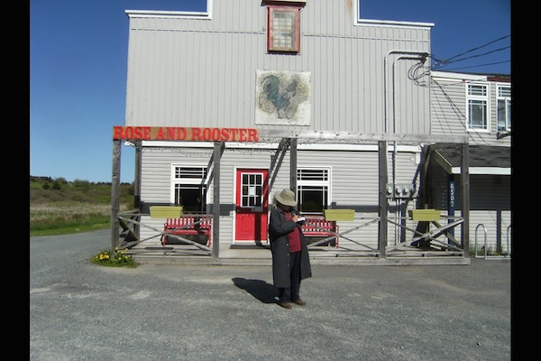 Liane Heller takes notes in front of the Rose and Rooster in Grand Desert. Photo: Tim Dunn