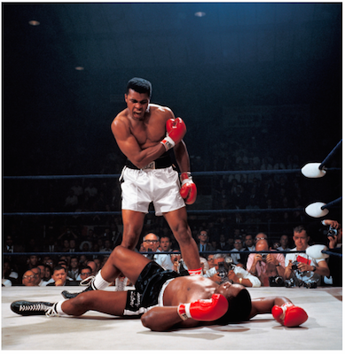Muhammad Ali reacts after his first round knockout of Sonny Liston during the 1965 World Heavyweight Title fight at St. Dominic's Arena. Lewiston, Maine 5/25/1965. Photo: Neil Leifer