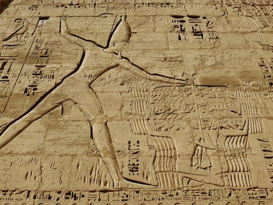 Pharaoh smiting his enemies with a club. Image from scottandmartadent.wordpress.com