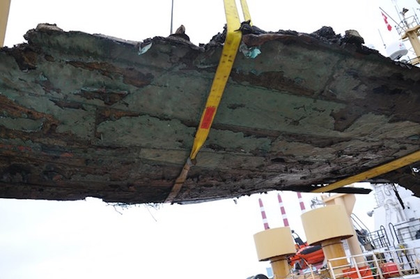 A six-metre-long portion of a wooden ship's hull was pulled from Georges Bank earlier this month by the Canadian Coast Guard vessel Alfred Needler. Much of the rotted hull is clad in copper, which leads marine historians to believe that the shipwreck could date back to the 19th century. Photo: Canadian Coast Guard