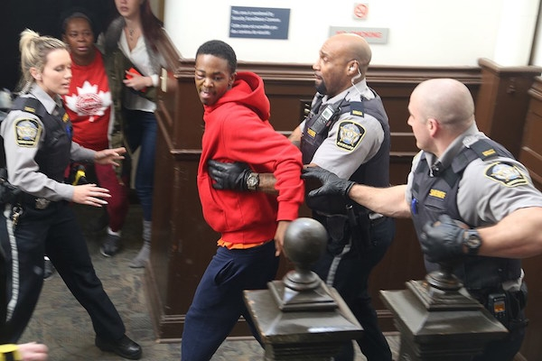 Carvel Clayton is rushed from the courtroom at Halifax provincial court after he was attacked following a court appearance on Monday. Photo: Ryan Taplin/ Local Xpress