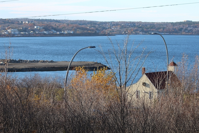 The new land at the port is arching towards the Africville church. Photo: Halifax Examiner