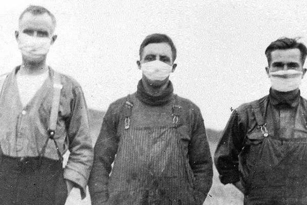 A photo of three men wearing masks