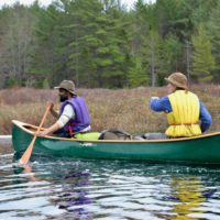 Two people in a canoe.