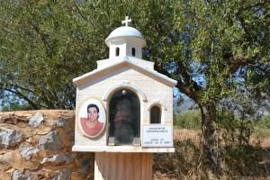 Greek roadside shrine in the shape of a small church.