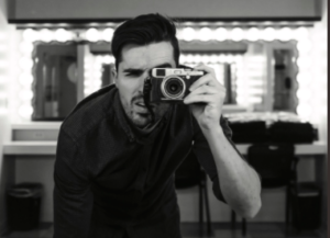 Man with camera taking photo in mirror