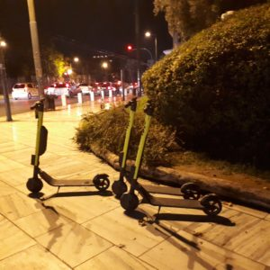 3 e-scooters on the street in Athens