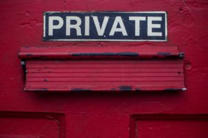 "Mail slot with the word ""private."""