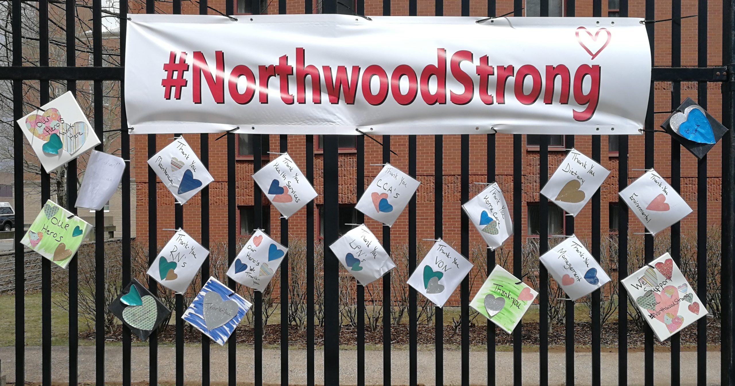 Northwood strong banner attached to a fence.