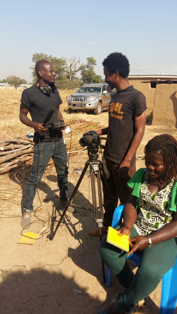 Armand Bayala (centre) filming in rural communities in northern Ghana in 2018.