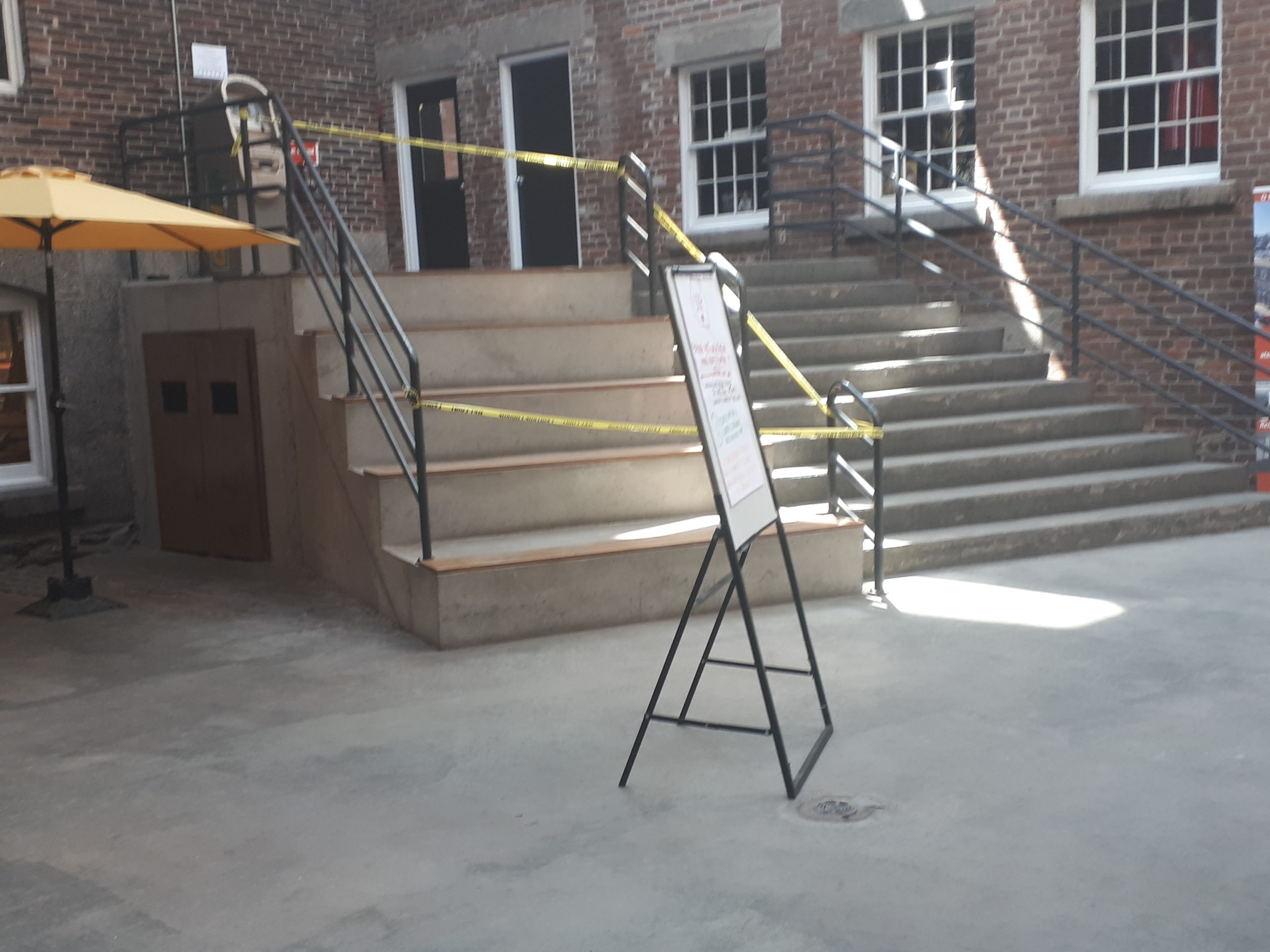 Roped-off seating area with stairs