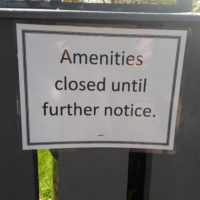 """Sign saying """"amenities closed until further notice."""""""