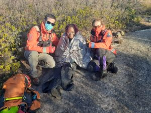 Cecilia Khamete with volunteers from Halifax Search and Rescue after the team found her and her friend after they got lost in Blue Mountain wilderness during a hile.