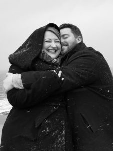 Black and white photo of a smiling, happy couple.