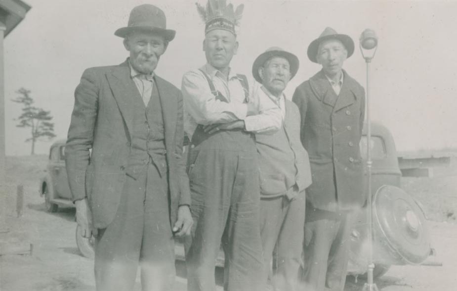 Archival image of four indigenous men