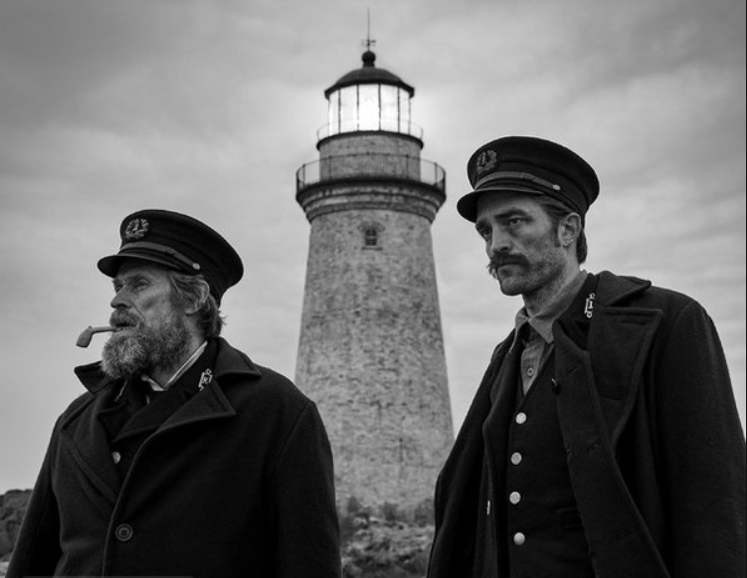 Black and white photo of two actors as old-time lighthouse keepers