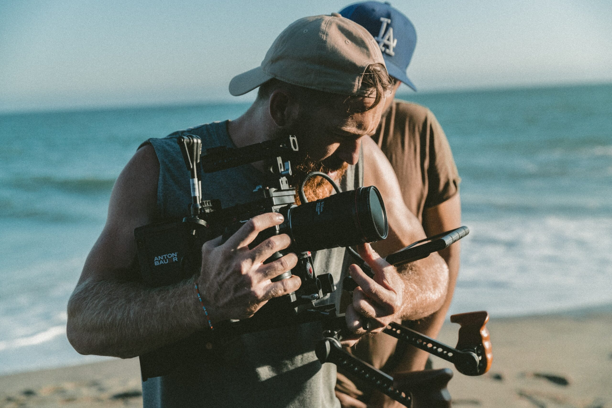 Hipster man with camera on beach