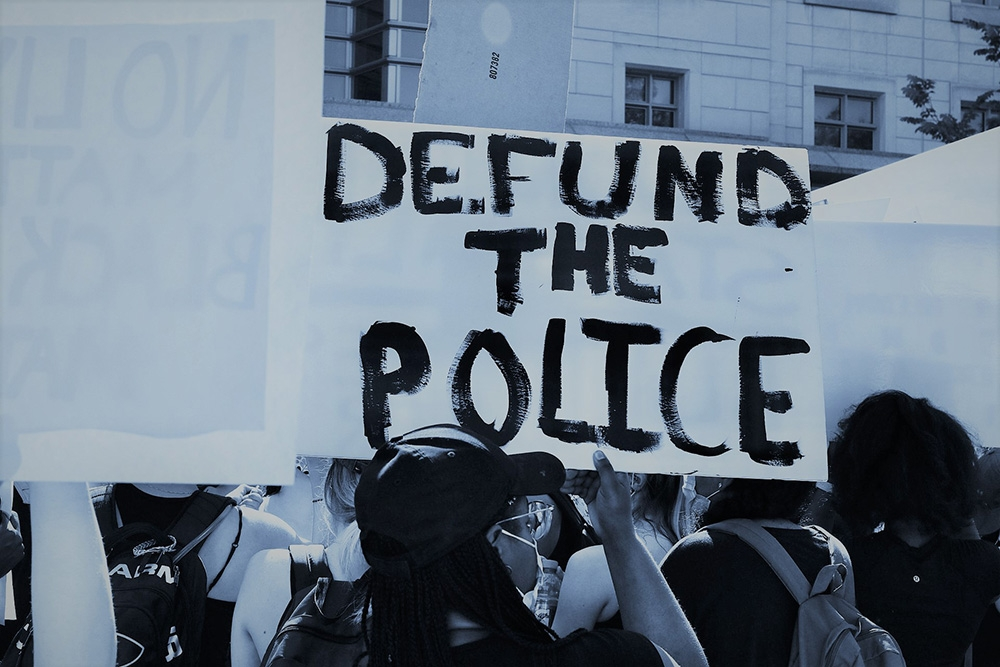 """Sign at a protest reading """"Defund the Police"""""""