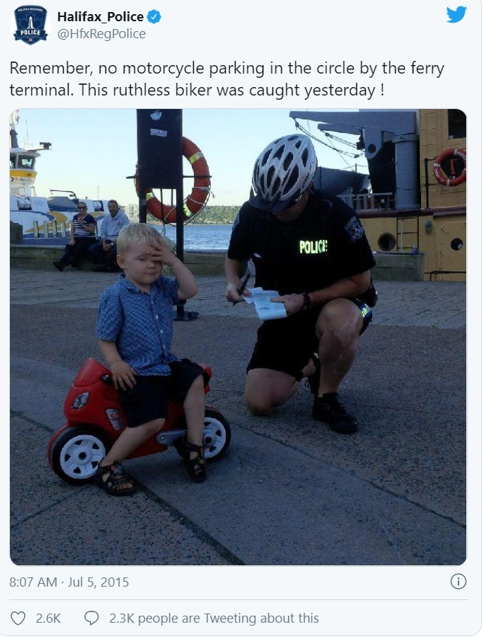 Tweet from Halifax Regional Police showing an officer writing a toddler a fake ticket.