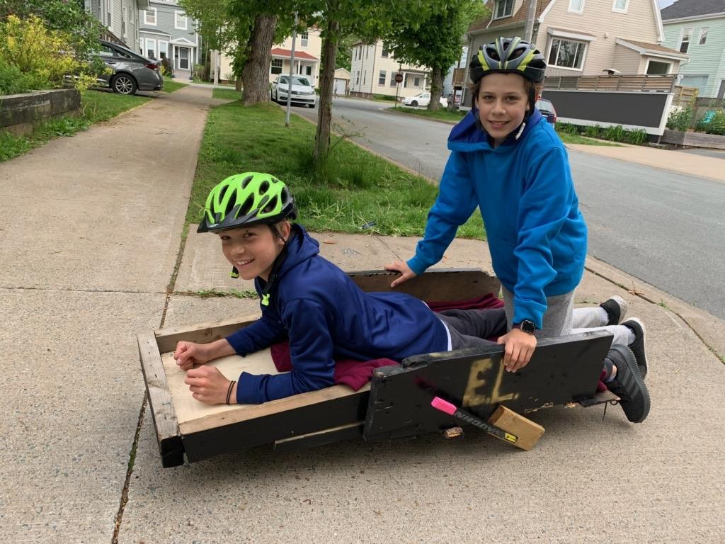 Two boys on their homemade go-kart