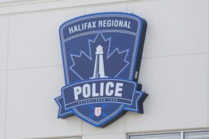 The crest of the Halifax Regional Police on their office wall.