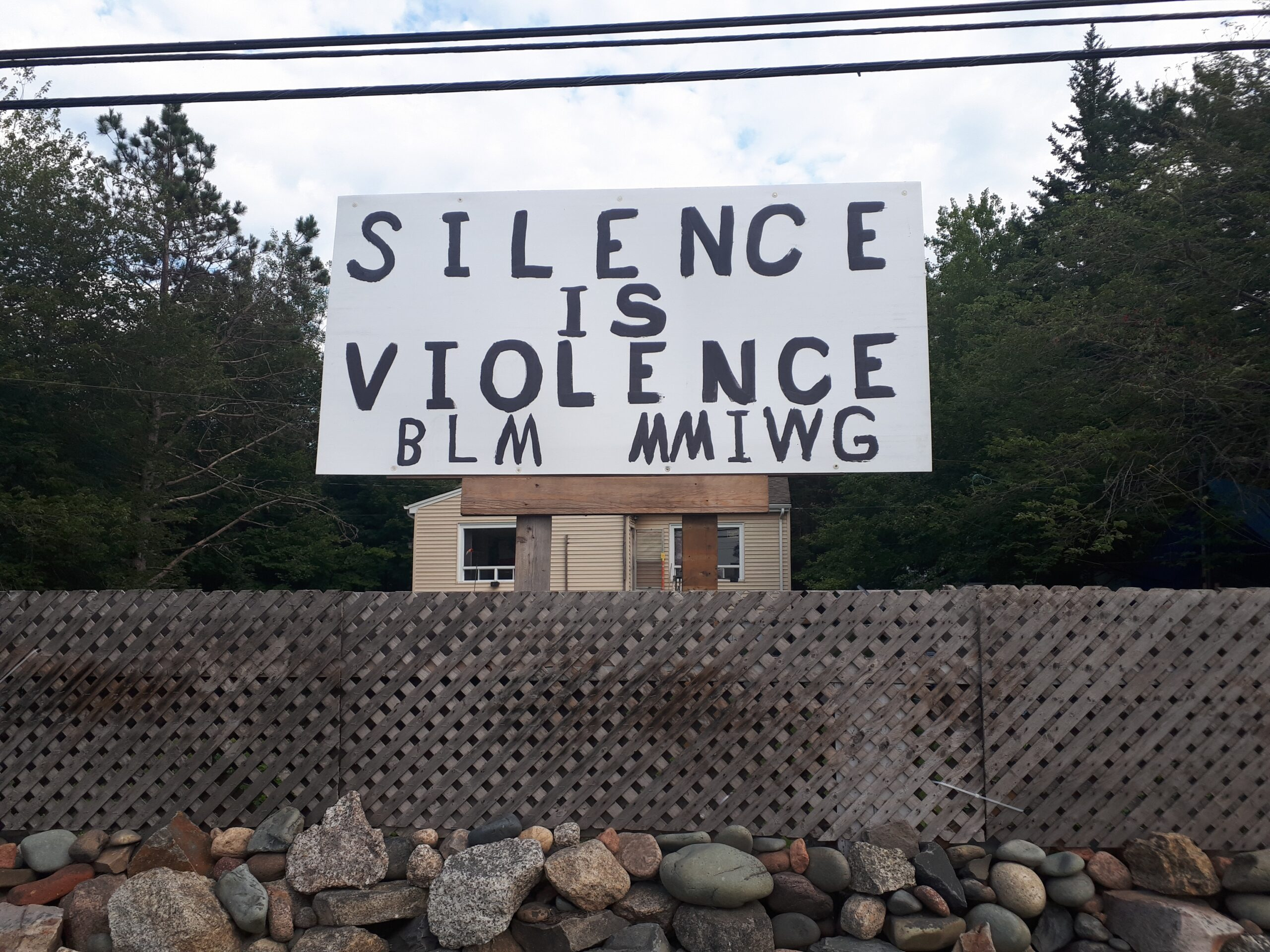 "Sign reading ""Silence is Violence BLM MMIWG"""