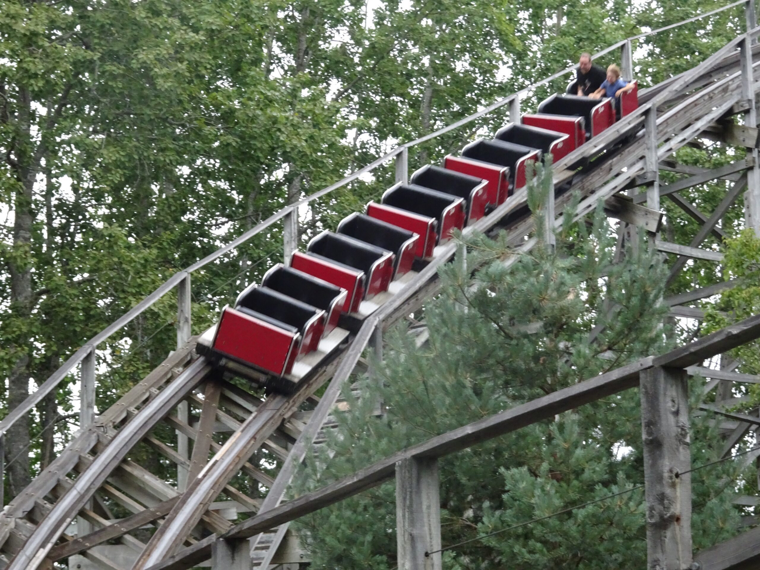 Roller coaster with car that's empty except for the last seat.