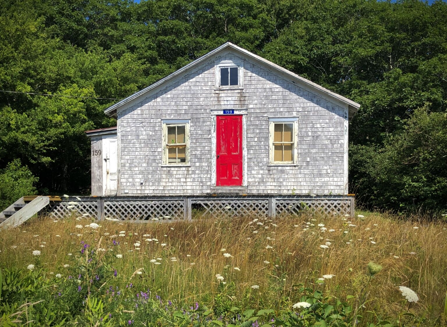 Small cottage with bright red door.