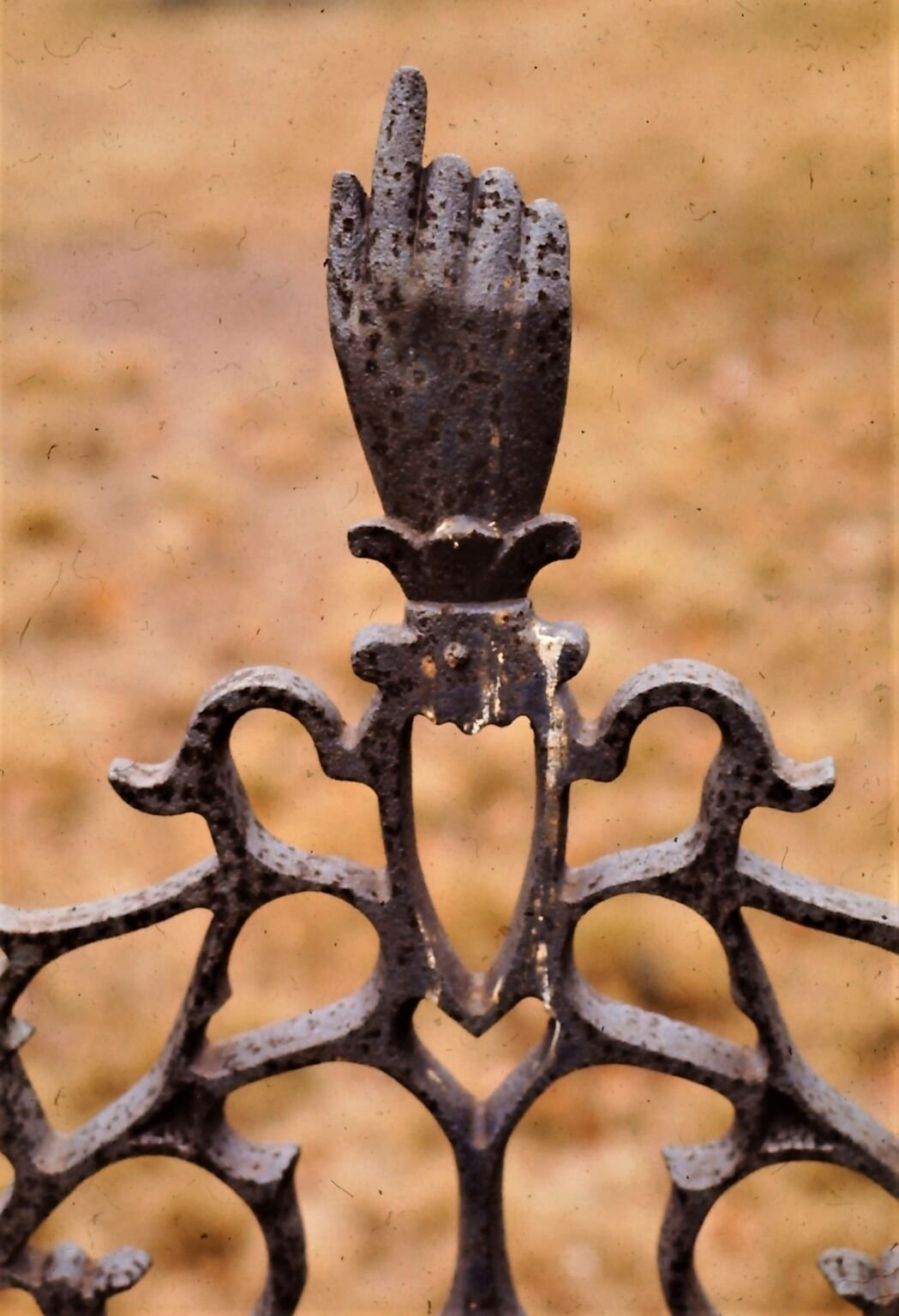 Cast iron grave marker with hand pointed to the sky