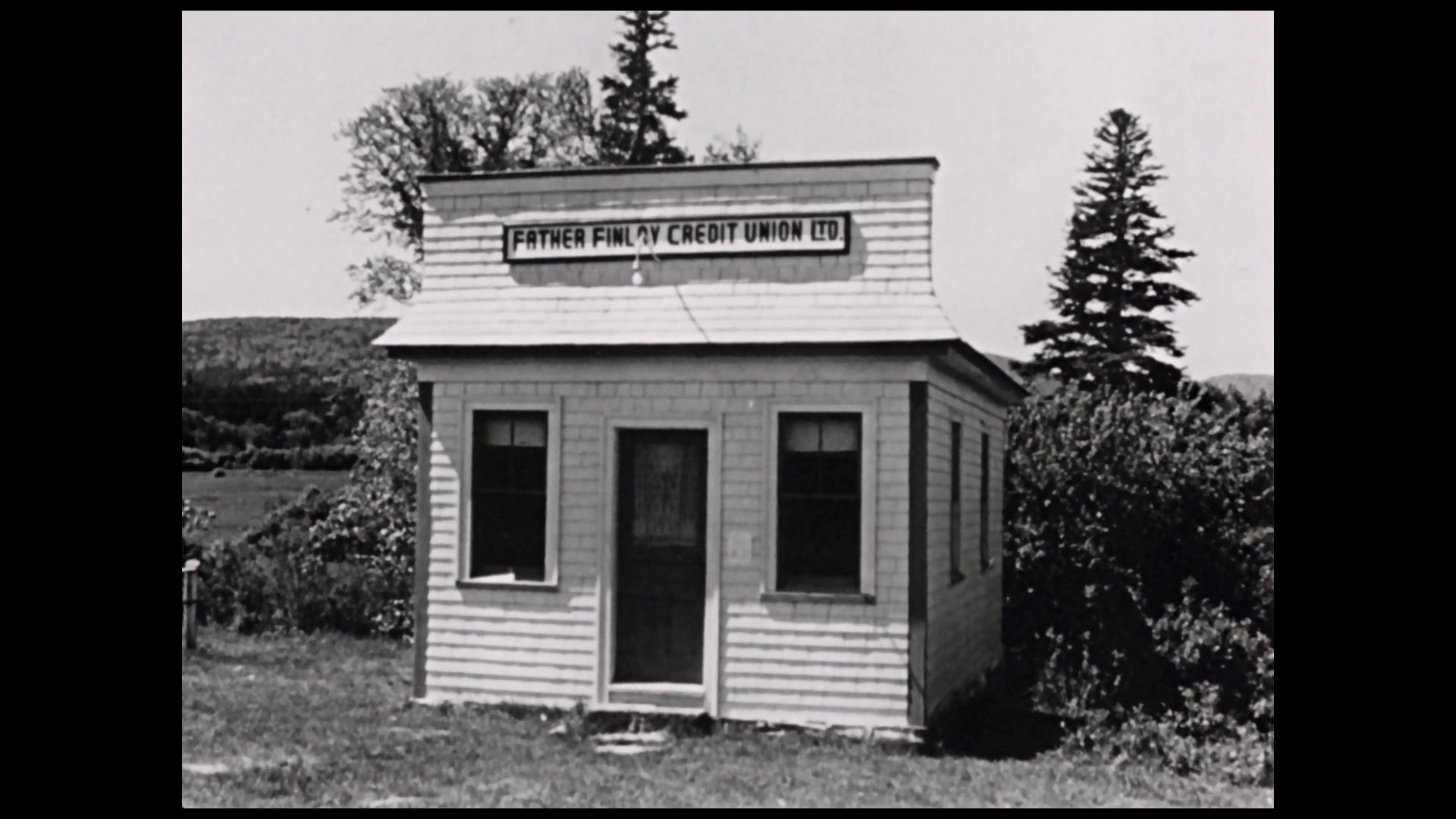 Tiny wooden building with a sign saying Father Finley Credit Union