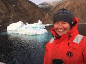 photo of Megan Leslie in front of a small iceberg