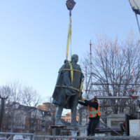 Cornwallis statue hangingin midair while being removed from its base