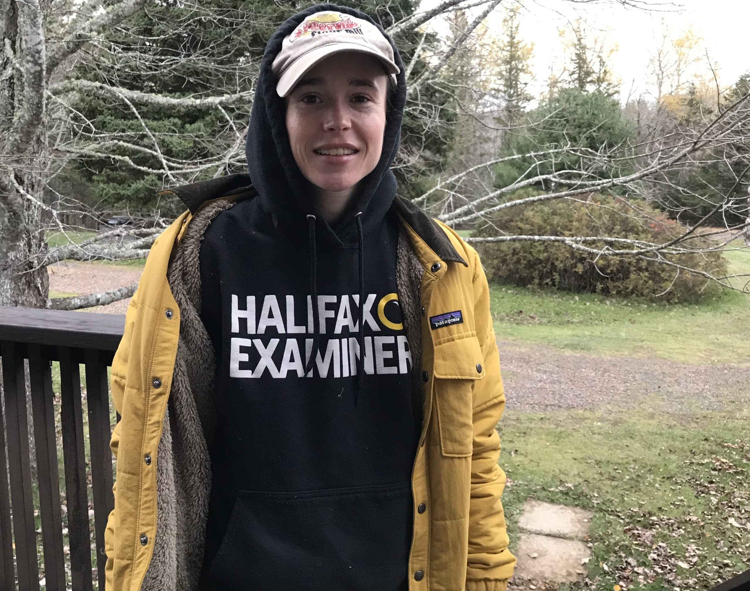 Elliot Page in a Halifax Examiner hoodie and ballcap