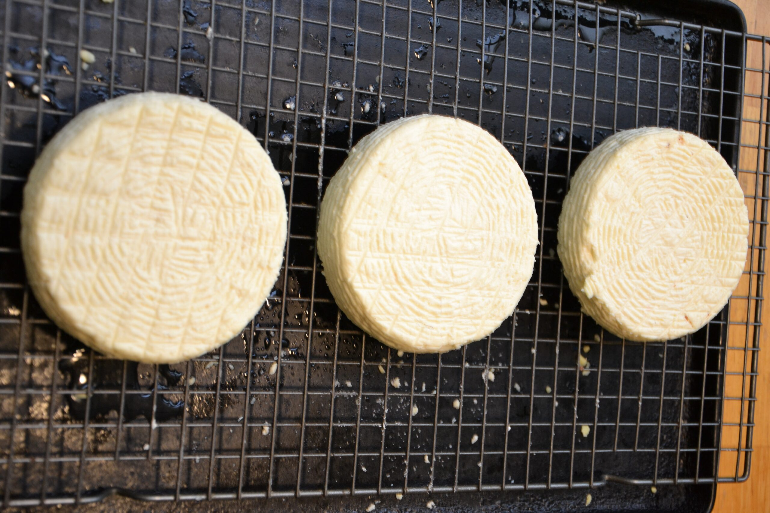 Three wheels of camembert-style cheese