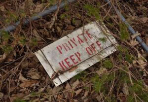 A photo of a sign saying private keep off