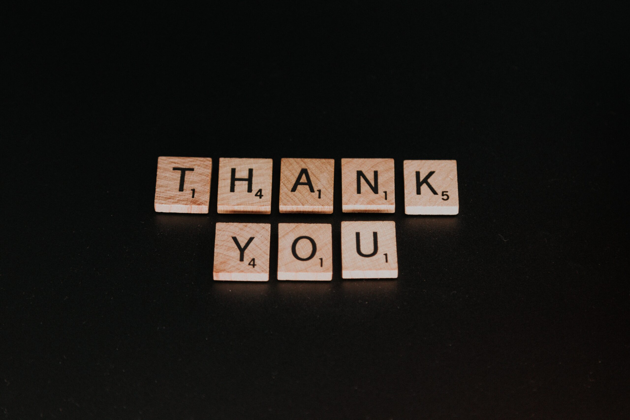 """Scrabble tiles spelling out """"Thank you"""""""