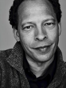 a black and white photo of author Lawrence Hill.